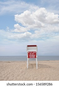 Government Shutdown No Life Guard on Duty Sign on Lifeguard station seat Beach Blue Sky Clouds