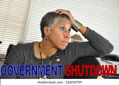 Government Shutdown Text Concern Mature Woman in Office Looking Upset