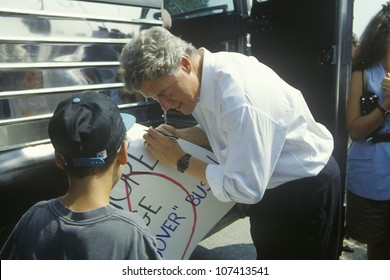 Governor Bill Clinton greets a child during the Clinton/Gore 1992 Buscapade Great Lakes campaign tour
