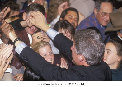 Governor Bill Clinton greets the crowd at a Denver campaign rally in 1992 on his final day of campaigning in Denver, Colorado