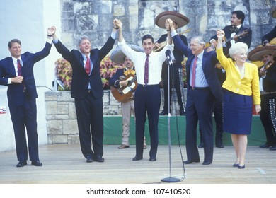 Governor Bill Clinton joins hands at Arneson River during the Clinton/Gore 1992 Buscapade campaign tour in San Antonio, Texas