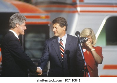 Governor Bill Clinton and Senator Al Gore shake hands at a Ohio campaign rally in 1992 on his final day of campaigning, Cleveland, Ohio