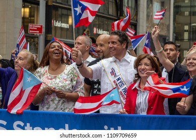 Governor Mario Coumo, Senator Ruben Diaz and other politicians march in the 2018 National Puerto Rican Day Parade in New York City.