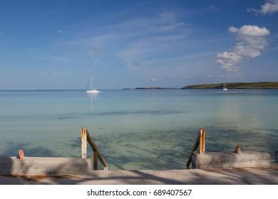 Governor's Harbour, Eleuthera, Bahamas - Cruising sailboats at anchor visiting the Out Island settlement on Eleuthera Island in the Bahamas
