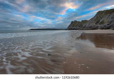 Gower evening and incoming tide at The Great Tor and Three Cliffs Bay, Swansea