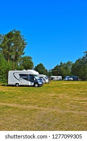 Gowerton, Swansea County Borough / Wales UK - 7/7/2018: Neat rows of modern caravans & motorhomes parked up on site at Gowerton Caravan & Motorhome Club Site, Gowerton, South Wales