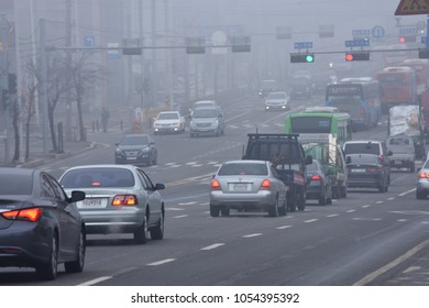 Goyang-si, Gyeonggi-do, Korea. dec. 7th, 2017 : The cars are running on a road full of fine dust.