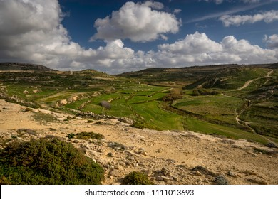 Gozo interior rural landscape, terraced fields around San Lawrenz and Dwejra Bay, countryside Malta, winter.
