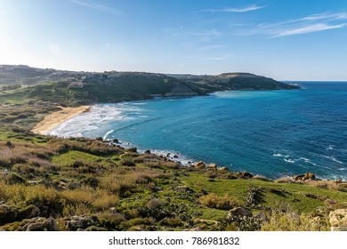 Gozo island Malta,  View of Ramla Bay, from inside Tal Mixta Cave Gozo looking out over the blue ocean on a bright day