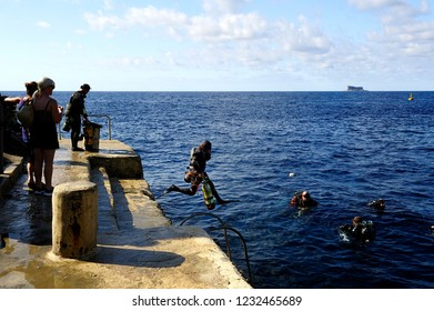 Gozo, Malta - 8th October 2018:Driver stepping off the quayside