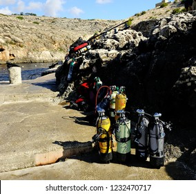 Gozo, Malta - 8th October 2018:Lots of divers air tanks ready for a dive on the quayside