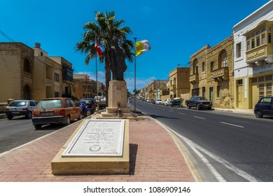 Gozo , Malta - August 03 2016: Monument to Pope John Paul II. Day view of statue at Triq Sant Orsola street Victoria Town, Malta.