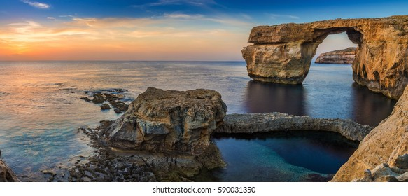 Gozo, Malta - Panoramic view of the beautiful Azure Window, a natural arch and famous landmark on the island of Gozo at sunset