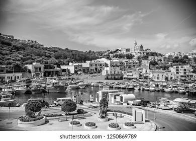GOZO, MALTA - September 2018: View of Mgarr Harbour, the main port on Gozo island, Malta. Black and white photo