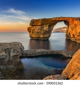 Gozo, Malta - Sunset at the beautiful Azure Window, a natural arch and famous landmark on the island of Gozo