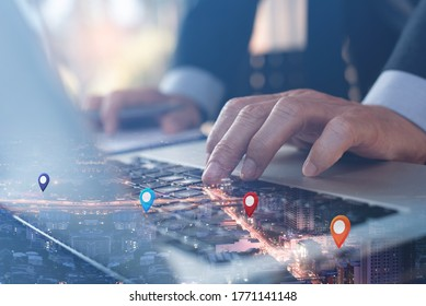 GPS map, pin address location on mobile apps. Double exposure of man hand using laptop computer searching target place on night cityscape. Business and technology, marketing plan concept