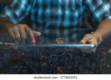 GPS map, pin address location on mobile apps. Double exposure of man hand using digital tablet searching target place on night cityscape while working in office.