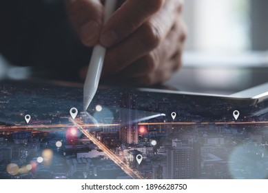 GPS map, pin address location on mobile apps, social media marketing plan, business and technology concept. Double exposure man using digital tablet searching and pinning target place on night city