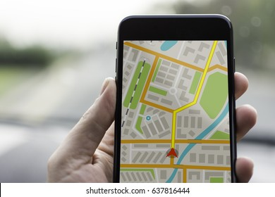 GPS Navigation on Mobile Phone Device and Transportation Concept. Male Hand Using Navigation System Map Tracking on Smartphone with Copy Space.