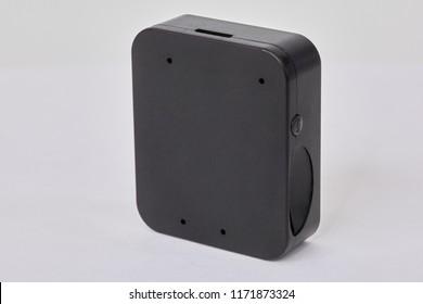 GPS tracker box on white background.
