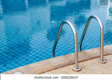 Grab bars ladder in blue the swimming pool