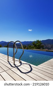 Grab bars ladder in the swimming pool, outdoor