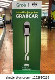 Grab Car signs in Airport: Jakarta, Indonesia - 7 December 2018