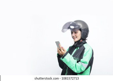 Grab driver on phone. Grab is technology company that offers wide range of ride-hailing and logistics services. yogyakarta indonesia. may 01, 2018