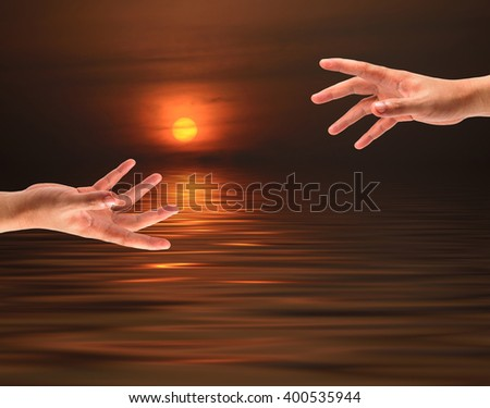Grab Hand On Sunset Sea Background Stock Photo (Edit Now