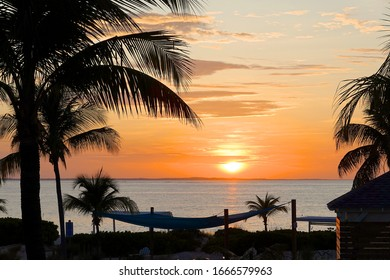 Grace Bay, Turks & Caicos Islands / British Overseas Territory - February 21, 2020: Dramatic sunsets are a regular feature on the long sandy beaches of Grace Bay near Providenciales in Turks & Caicos.