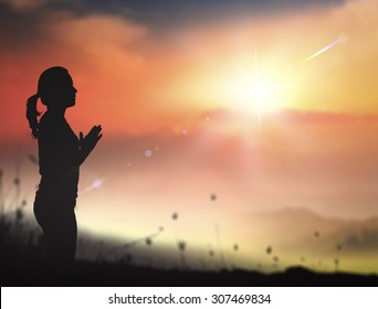 Grace of God concept: Faith woman praying from the word of holy bible.