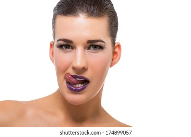 Graceful attractive woman with purple lips and nails portrait isolated