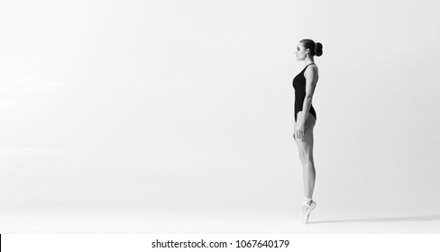 Graceful ballerina dancing in art performance.