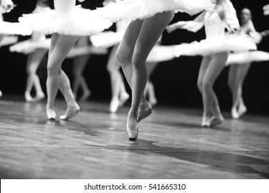 Graceful ballerinas feet dancing on ballet shoes on stage during a performance