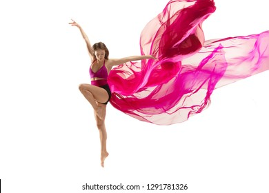 Graceful ballet dancer or classic ballerina dancing isolated on white studio. Woman dancing with pink silk cloth. The dance, performer, flexibility, elegance, performance, grace, artist, contemporary