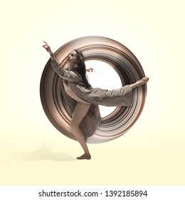Graceful ballet dancer or classic ballerina dancing isolated on studio background. Woman dancing in grey silk cloth. The dance, grace, artist, contemporary, movement concept. Abstract design.