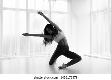 Graceful Ballet Perfomer Training in Spacious Dance Class. Black and White, Empty Space For Text