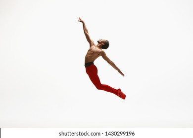 Graceful classic ballet dancer dancing isolated on white studio background. Man in bright red clothes like a combination of wine and milk. The dance, grace, artist, movement, action and motion concept