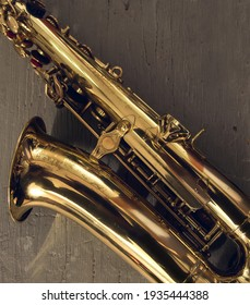 graceful classical musical instrument bronze saxophone on old wooden background