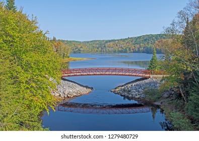 Graceful Footbridge by a Arrowhead Lake in the North Woods of Arrowhead Provincial Park in Ontario