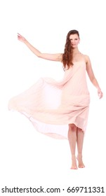 graceful girl in flying light pink dress, isolated on a white background