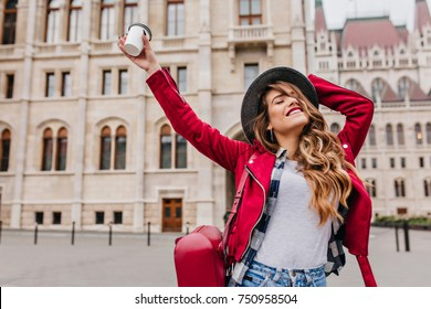 e64f8e2b84e Graceful girl in trendy casual attire enjoying european travel in weekend.  Outdoor photo of blissful