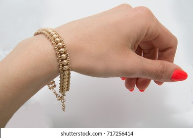Graceful golden bracelet isolated on woman hand