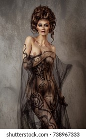 Graceful  nude young girl with black body painting