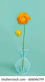 Graceful persian buttercup flowers in a blue vase on a pretty blue background