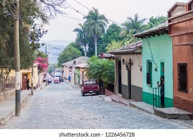 GRACIAS, HONDURAS - APRIL 13, 2016: Cobbled street in Gracias town.