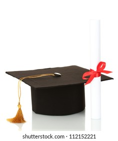 Grad hat and diploma isolated on white