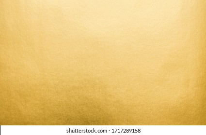 Gradation gold foil leaf shiny with sparkle yellow metallic texture background. Abstract paper glitter golden glossy for template. top view. - Shutterstock ID 1717289158