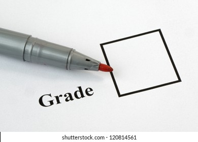 Grade box on an exam paper, with pen.36 mp image