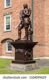 A Grade II listed statue of Oliver Cromwell  on a plinth in the grounds of the Warrington Academy Building Warrington Cheshire May 2018